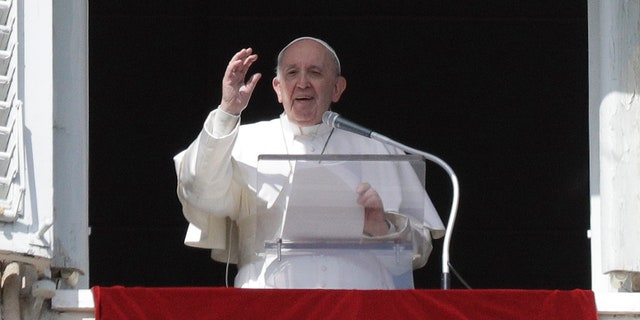 Pope Francis delivers the Angelus noon prayer in St. Peter's Square at the Vatican on Feb. 28.