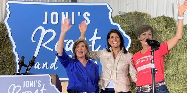 Former U.S. ambassador to the United Nations Nikki Haley joins Sen. Joni Ernst of Iowa and Iowa Gov. Kim Reynolds at a political event in Boone, Iowa in June of 2019.