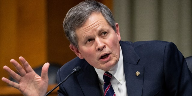 Sen. Steve Daines, R-Mont., speaks during a Senate Finance Committee hearing on the nomination of Xavier Becerra to be Secretary of Health and Human Services on Capitol Hill in Washington, Wednesday, Feb. 24, 2021. Daines' Montana has one of the longest borders with Canada in the United States. (Michael Reynolds/Pool via AP)