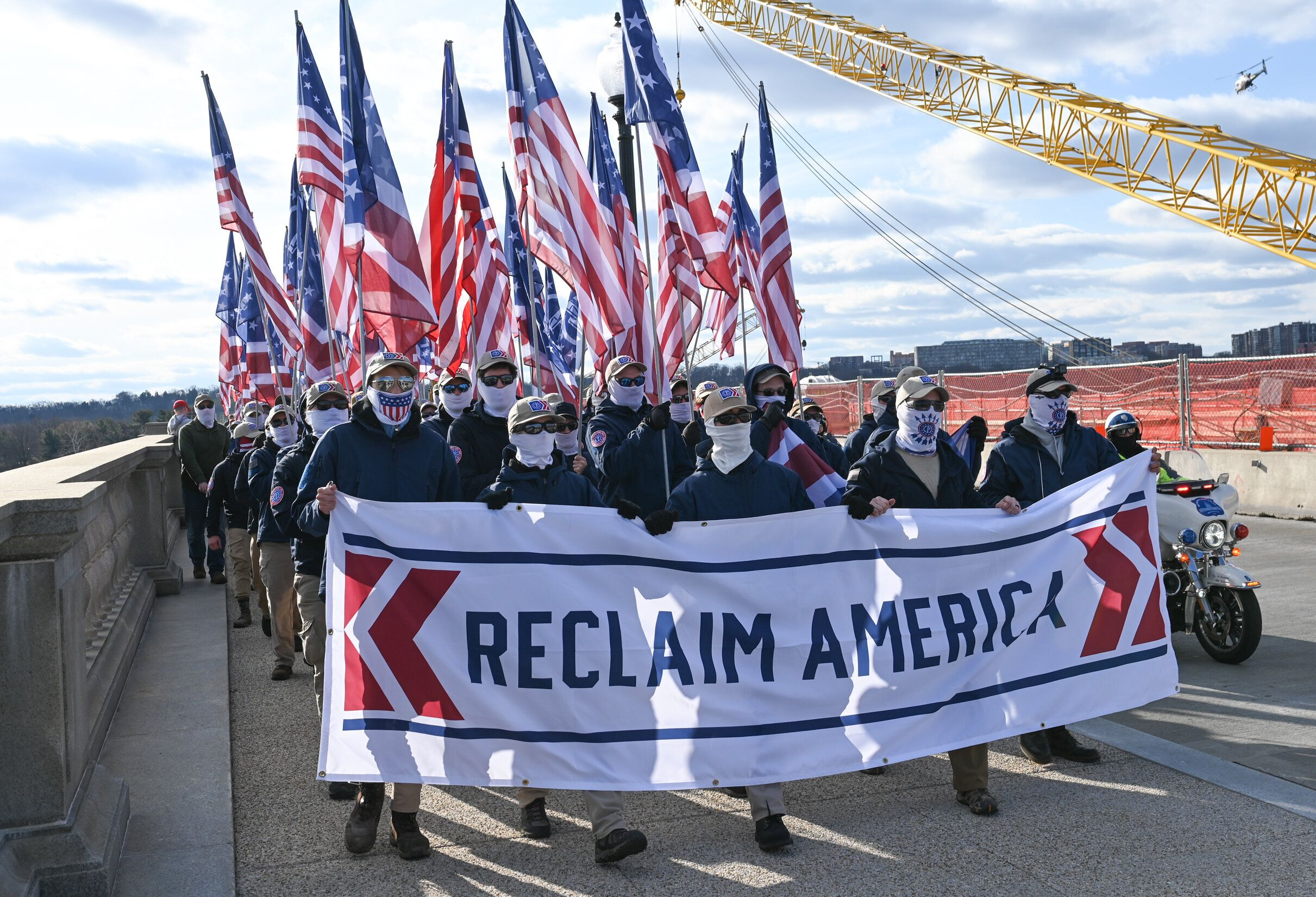 Patriot Front members march from the Lincoln Memorial to the U.S. Capitol, escorted by D.C. Metro Police, on Feb. 8, 2020.
