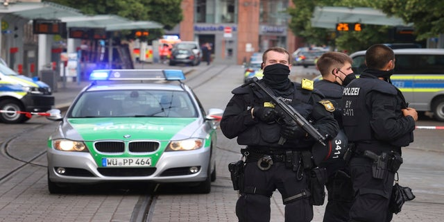 Police cars attend the scene of an incident in Wuerzburg, Germany, Friday June 25, 2021. (Karl-Josef Hildenbrand/dpa via AP)