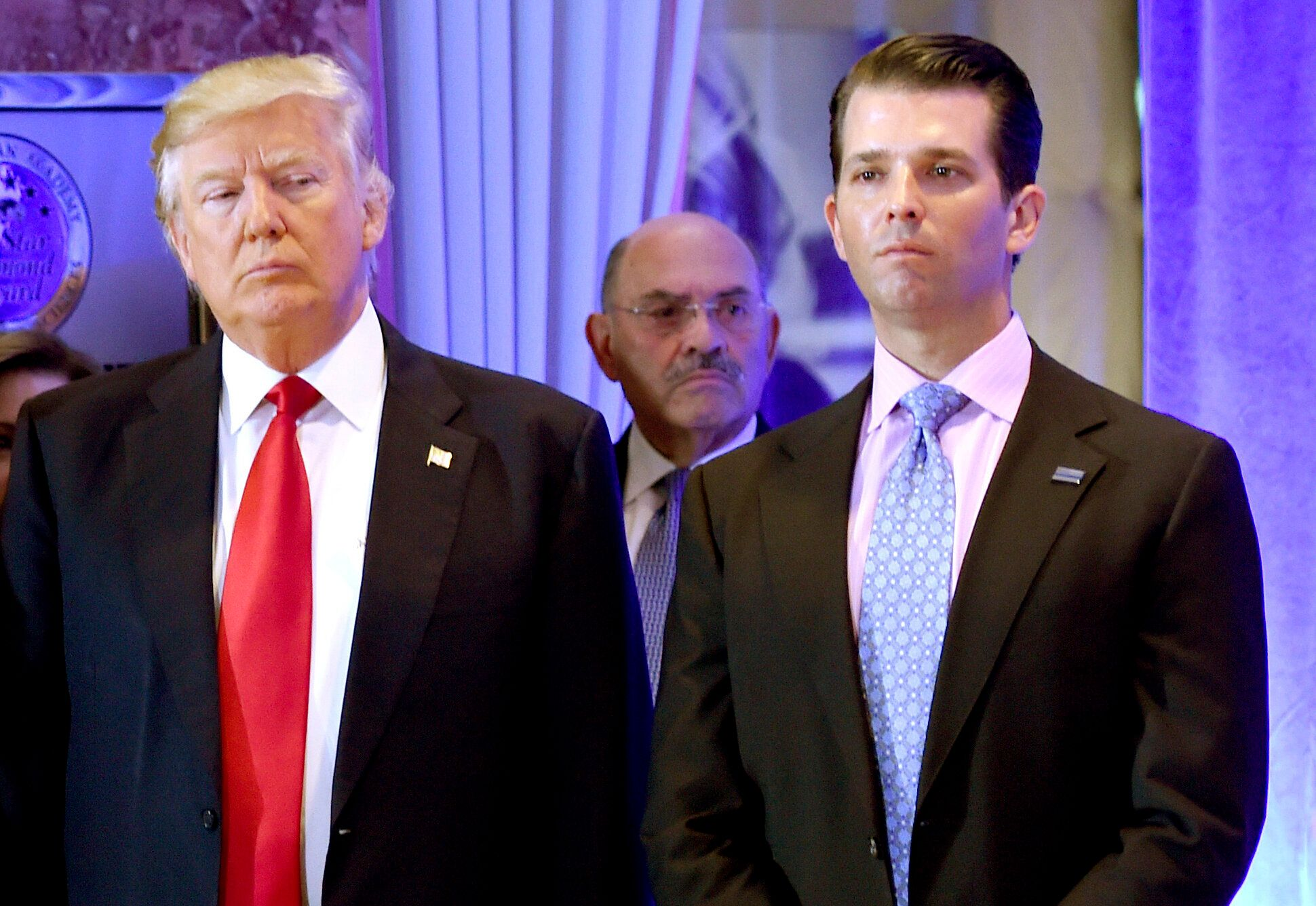 Former President Donald Trump pictured with Allen Weisselberg (center) and his son, Donald Trump Jr., in 2017.