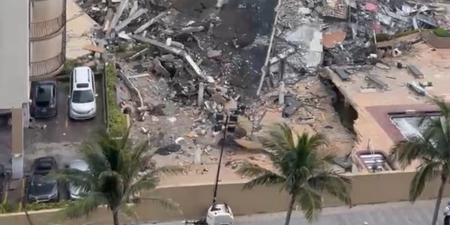 A pile of rubble about 30-feet high was left over after the building collapsed on Thursday.