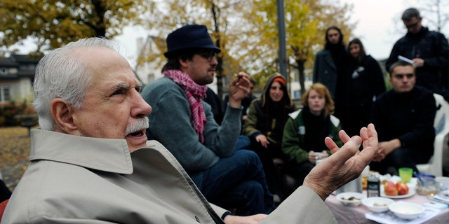 """FILE - Former Democratic U.S. senator Mike Gravel gestures while talking to """"Occupy"""" activists at Lindenhof square in Zurich, Switzerland, in this Monday, Oct. 31, 2011, file photo. Gravel, a former U.S. senator from Alaska who read the Pentagon Papers into the Congressional Record and confronted Barack Obama about nuclear weapons during a later presidential run, has died. He was 91. Gravel, who represented Alaska as a Democrat in the Senate from 1969 to 1981, died Saturday, June 26, 2021. Gravel had been living in Seaside, California, and was in failing health, said Theodore W. Johnson, a former aide. (AP Photo/Keystone, Steffen Schmidt, File)"""
