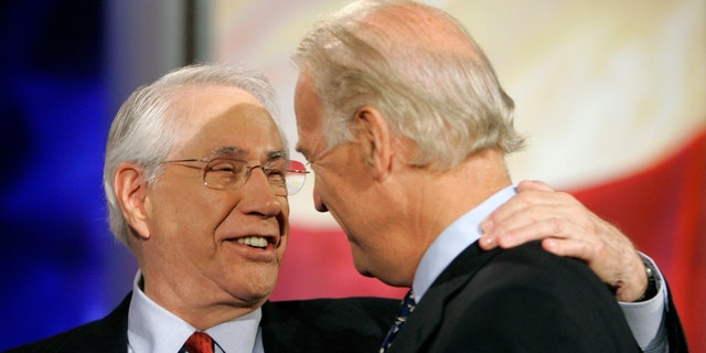 FILE - Democratic presidential hopefuls former Alaska Sen. Mike Gravel, left, and Sen. Joe Biden, D-Del., talk on stage during a break in the ABC News Democratic candidates debate at Drake University in Des Moines, Iowa, in this Sunday, Aug. 19, 2007, file photo. Gravel, a former U.S. senator from Alaska who read the Pentagon Papers into the Congressional Record and confronted Barack Obama about nuclear weapons during a later presidential run, has died. He was 91. Gravel, who represented Alaska as a Democrat in the Senate from 1969 to 1981, died Saturday, June 26, 2021. Gravel had been living in Seaside, California, and was in failing health, said Theodore W. Johnson, a former aide. (AP Photo/Charlie Neibergall, File)