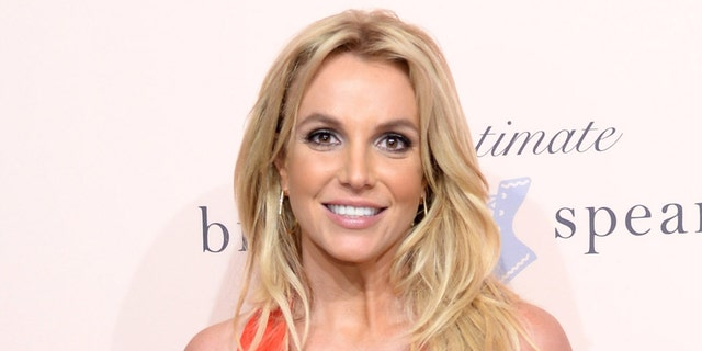 """All Britney Spears wants is to be the mom of a little girl — a dream that's been blocked because she's imprisoned in a """"corrupt and evil"""" conservatorship, a former boyfriend said after hearing her impassioned testimony on Wednesday. (Kevin Mazur/Getty Images for The Intimate Britney Spears)"""
