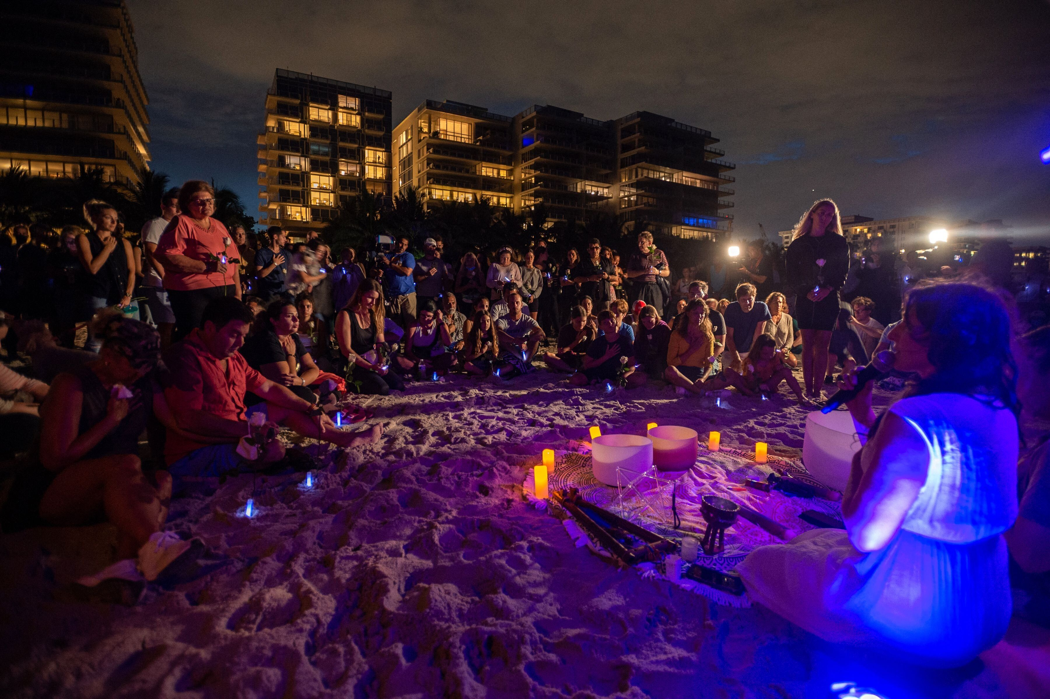 People attend a community vigil on the beach for those missing.