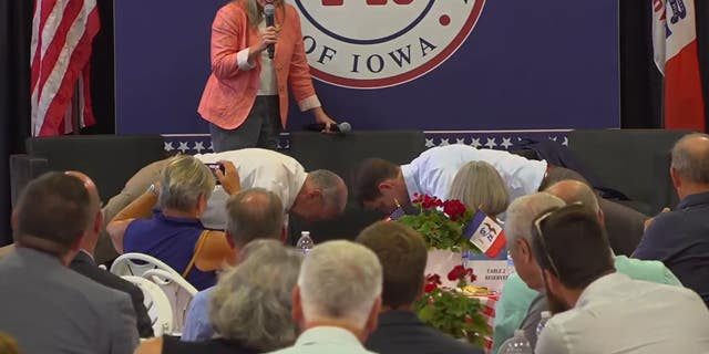 Sens. Chuck Grassley R-Iowa., and Tom Cotton R-Ark., do 22 push-ups at an event Tuesday in Iowa, while the state's other Republican senator, Joni Ernst, 50, counts them off