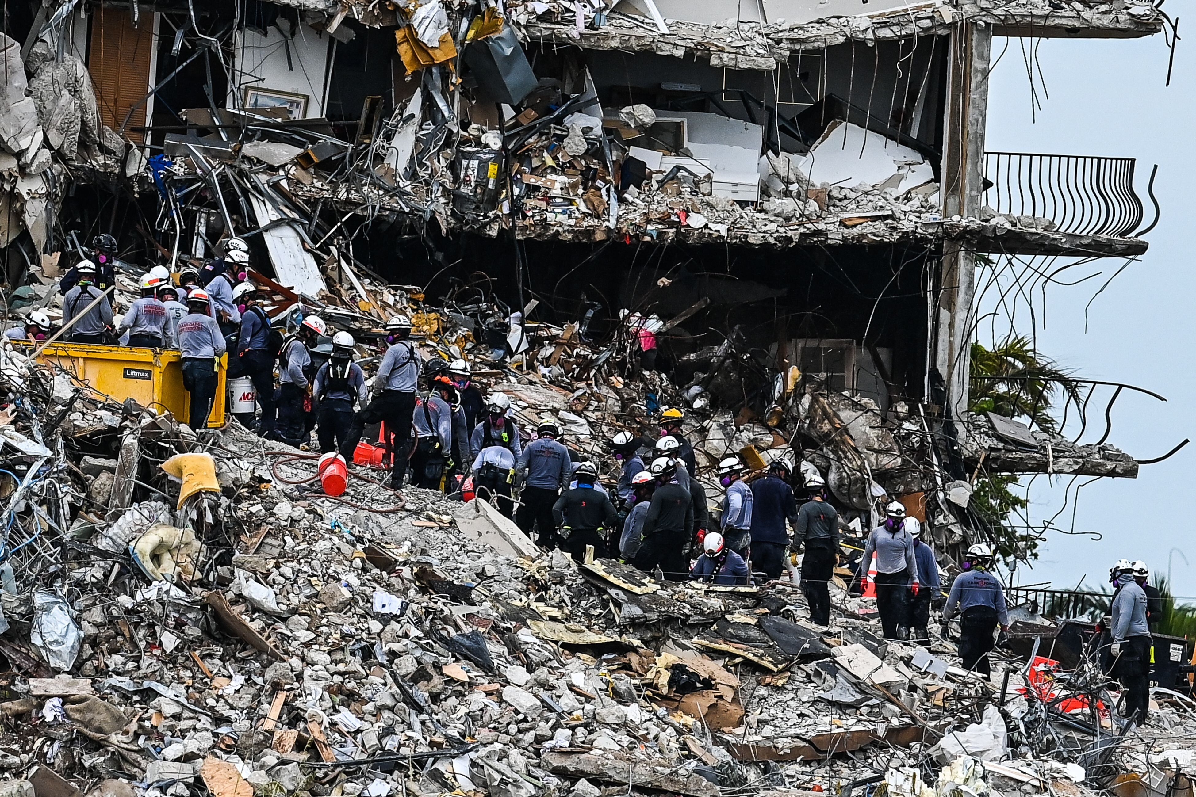 Search and Rescue teams look for possible survivors in the partially collapsed 12-story Champlain Towers South condo building