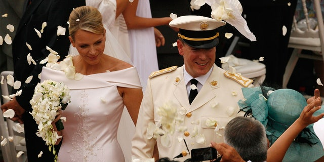 Princess Charlene of Monaco and Prince Albert II of Monaco leave the religious ceremony of the Royal Wedding of Prince Albert II of Monaco to Princess Charlene of Monaco at the Prince's Palace on July 2, 2011 in Monaco. The Roman-Catholic ceremony follows the civil wedding which was held in the Throne Room of the Prince's Palace of Monaco on July 1. With her marriage to the head of state of Principality of Monaco, Charlene Wittstock has become Princess consort of Monaco and gain the title, Princess Charlene of Monaco.