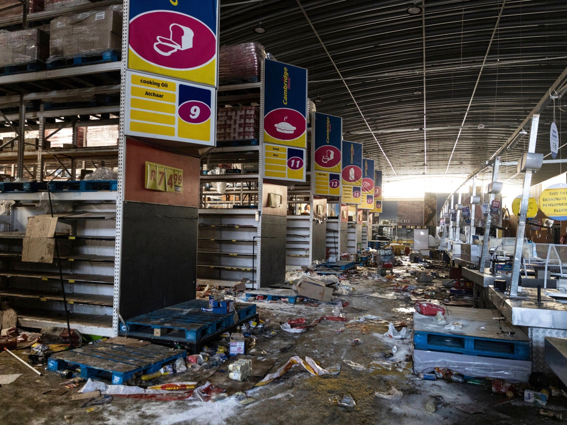 A picture taken in Vosloorus, southeast of Johannesburg, on July 12, 2021 shows the Gold Spot Shopping Centre after being looted. - South Africa said it was deploying troops to two provinces, including Johannesburg, after unrest sparked by the jailing of ex-president Jacob Zuma led to six deaths and widespread looting. Overwhelmed police are facing mobs who have ransacked stores. Six people have died, some with gunshot wounds, and 219 people have been arrested, according to a police tally issued before the army deployed. (Photo by GUILLEM SARTORIO / AFP) (Photo by GUILLEM SARTORIO/AFP via Getty Images)