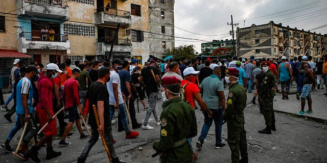 """Thousands of Cubans participated in Sunday's demonstrations, chanting """"Down with the dictatorship,"""" as President Miguel Díaz-Canel urged supporters to confront the protesters."""
