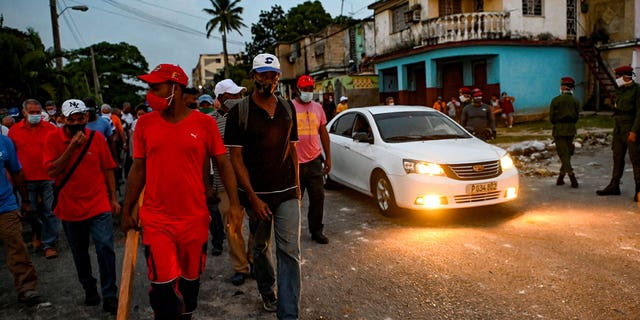 Cubans take part in a demonstration in support of Cuban President Miguel Diaz-Canel's government in Arroyo Naranjo Municipality, Havana on July 12, 2021.