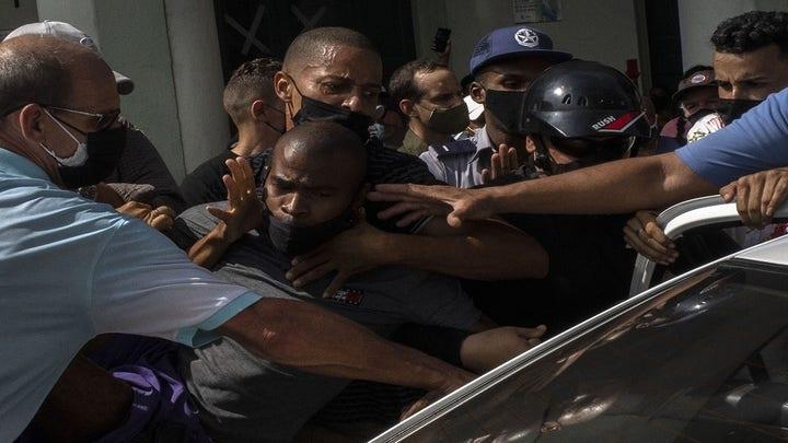 Cuban forces reportedly arrest dissidents as regime blames US for unrest