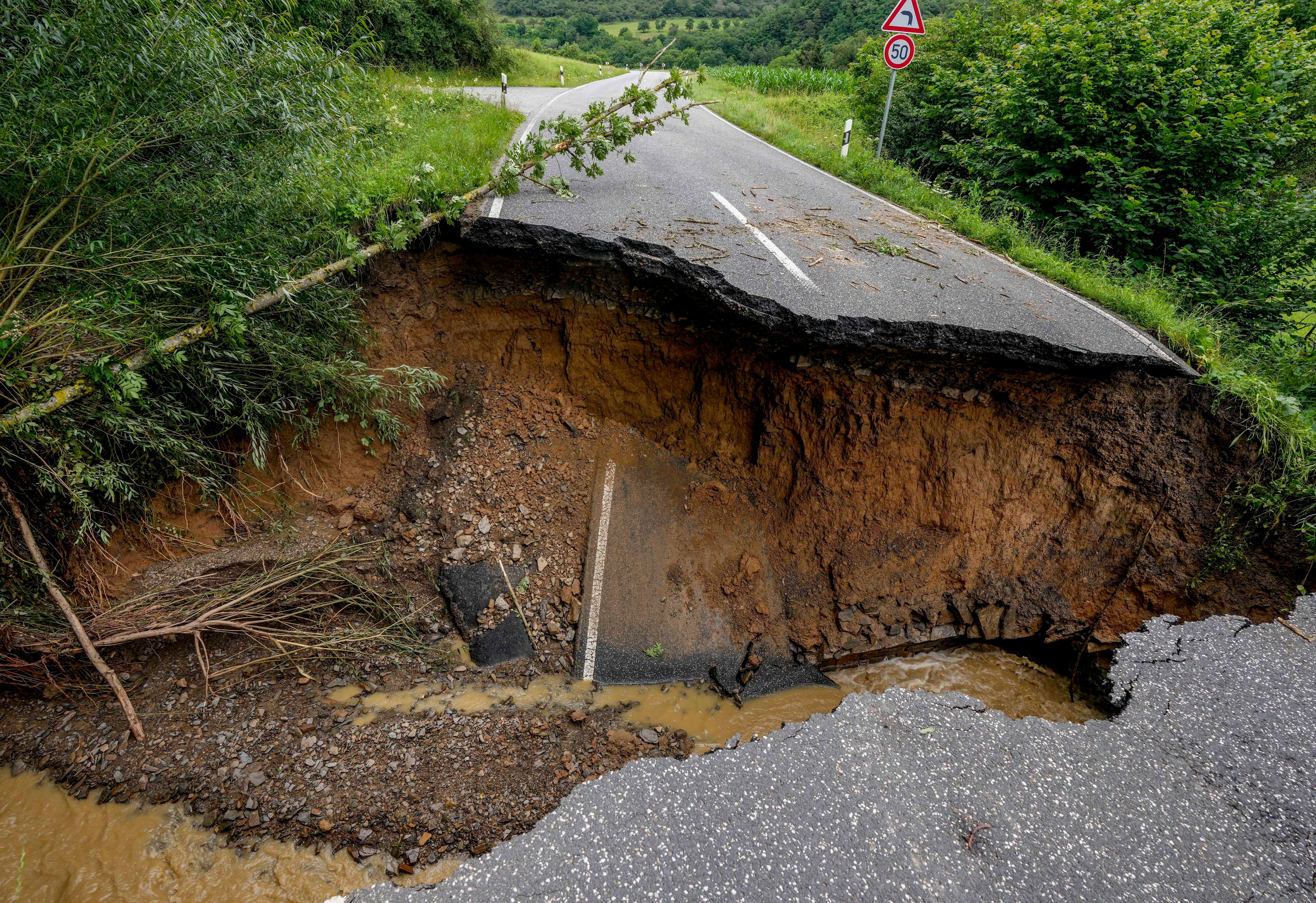 A street is destroyed between Insul and Schuld, in western Germany.