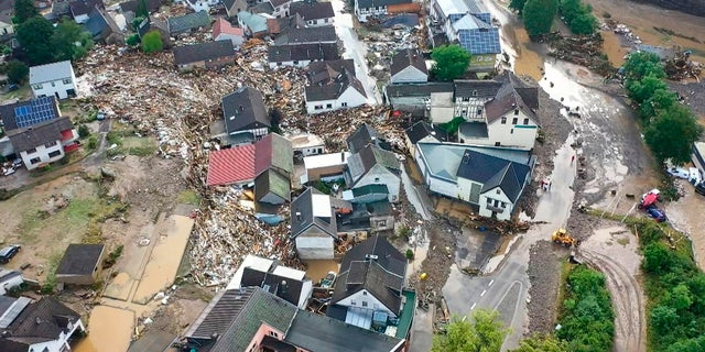 A photo, taken with a drone, shows the devastation caused by the flooding of the Ahr River in the Eifel village of Schuld, western Germany, Thursday, July 15, 2021. (Christoph Reichwein/dpa via AP)