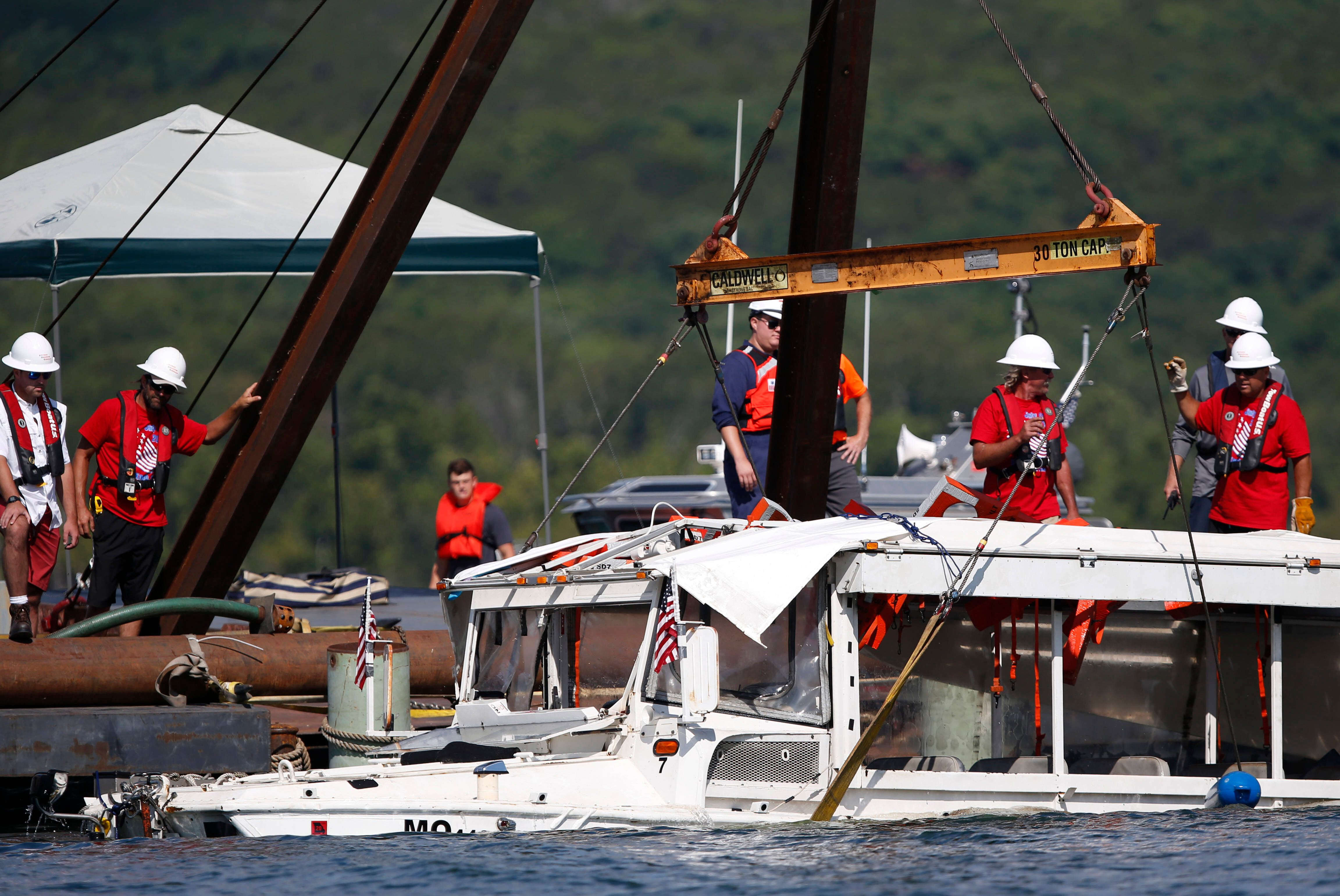In this July 23, 2018 file photo, a duck boat that sank in Table Rock Lake in Branson, Mo., is raised after it went down the
