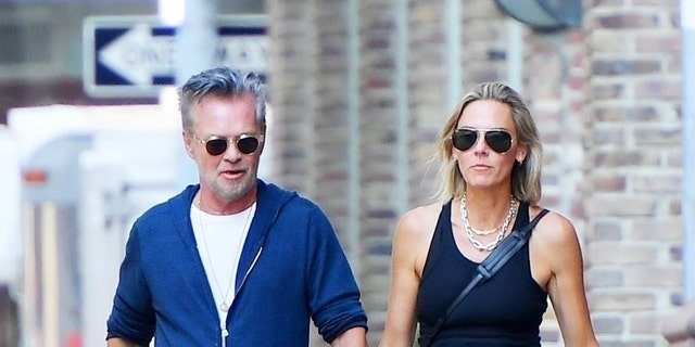 Mellencamp holds hands with his new real estate girlfriend Natasha Barrett in Tribeca.