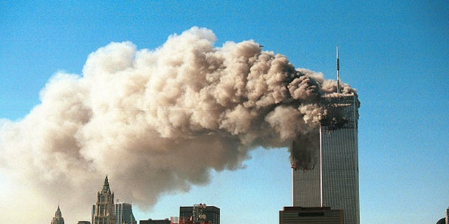 Smoke pours from the twin towers of the World Trade Center after they were hit by two hijacked airliners in a terrorist attack September 11, 2001 in New York City. (Photo by Robert Giroux/Getty Images)