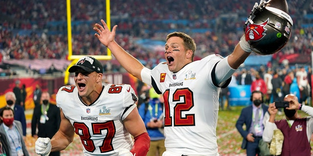 FILE - In this Sunday, Feb. 7, 2021 file photo, Tampa Bay Buccaneers tight end Rob Gronkowski (87), left, and Tampa Bay Buccaneers quarterback Tom Brady (12) celebrate together after the NFL Super Bowl 55 football game against the Kansas City Chiefs in Tampa, Fla. (AP Photo/Steve Luciano, File)