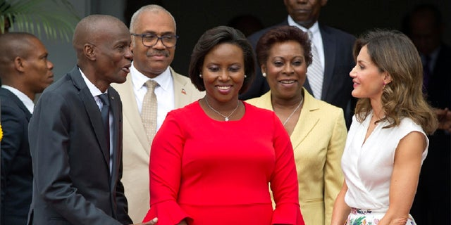 In this May 23, 2018, file photo, Assasinated President Jovenel Moise, left, and former First Lady Martine Moise, in red, receive Spain's Queen Letizia Ortiz at the national Palace in Port-au-Prince, Haiti, Wednesday, May 23, 2018. (AP)