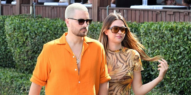 Scott Disick, 38, shared a couple of photos from his Friday night out with Hamlin, 20, and at least two of his kids — Reign, 6, and Penelope, 9. The couple is pictured here in Miami in April. (Photo by MEGA/GC Images)
