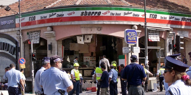 FILE: A gaping hole is left in the shop front of the Sbarro pizzeria after a suicide bombing that killed at least 15 people and wounded 122 others in Jerusalem August 9, 2001. The suicide bomber blew himself up at the restaurant during the busy lunch hour. Seven of the dead were children, including American Malki Roth, who was 15. NB/GB - RP2DRIDUUUAA