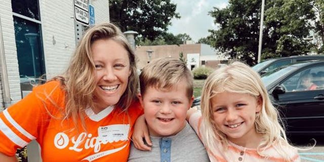 Grady Witkowski (middle), his Liquid Church buddy Katy Herridge (left) and his sister June Witkowski (right) pose arm-in-arm at the contemporary church they all enjoy in Parsippany, N.J.