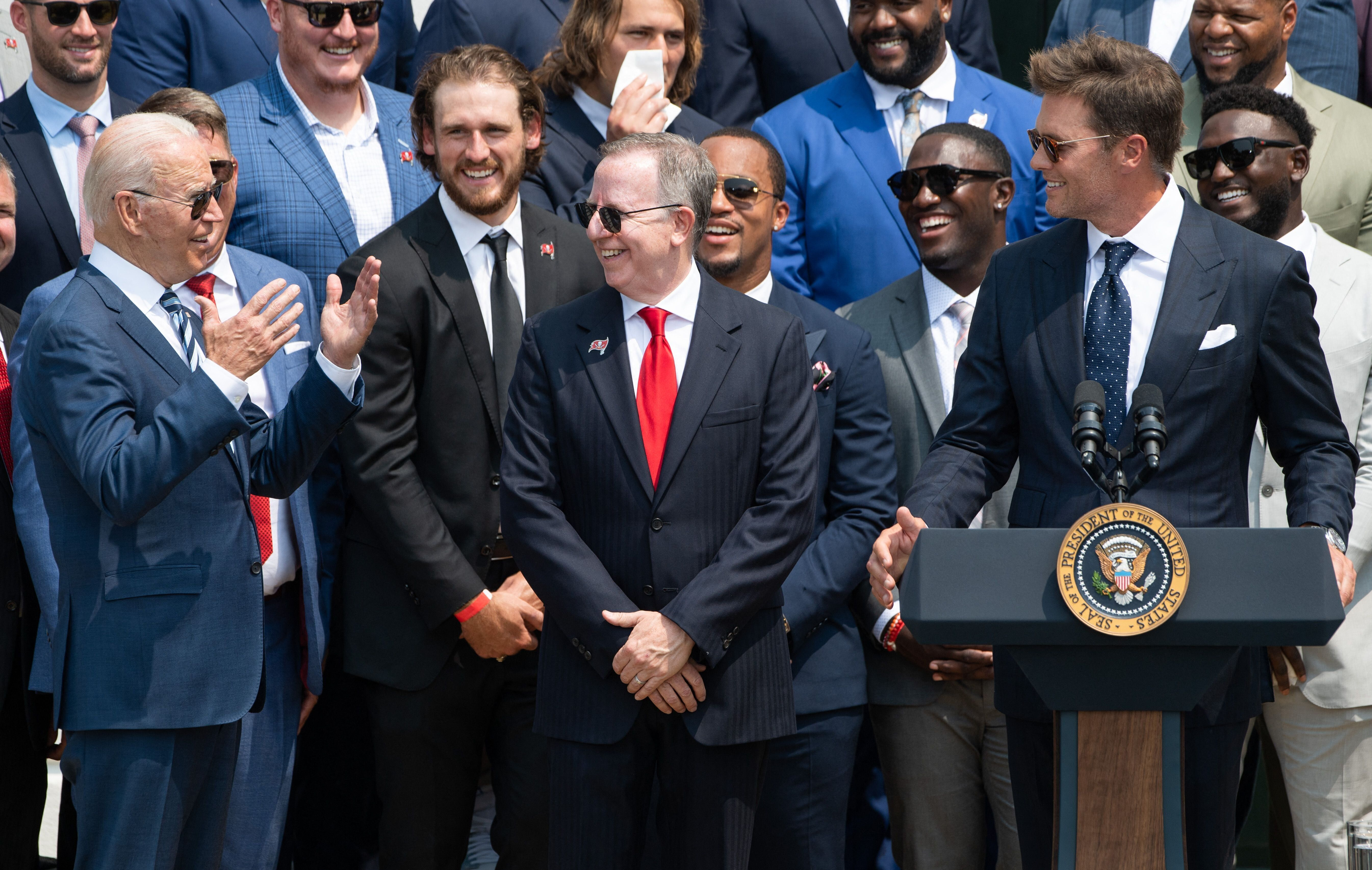 President Joe Biden interacts with Tom Brady and his teammates during a ceremony honoring the Tampa Bay Buccaneers for their