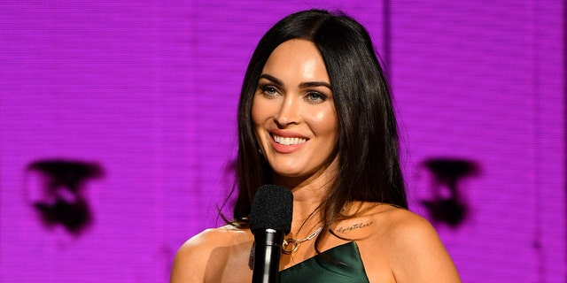 Megan Fox posed in a heart-shaped bikini top and more for Basic magazine.