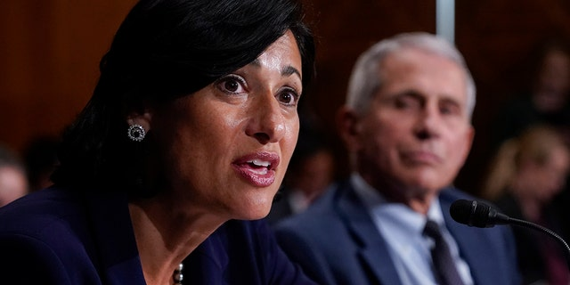 Dr. Rochelle Walensky, director of the Centers for Disease Control and Prevention (CDC), and top infectious disease expert Dr. Anthony Fauci, testify before the Senate Health, Education, Labor, and Pensions Committee on Capitol Hill in Washington, Tuesday, July 20, 2021. (AP Photo/J. Scott Applewhite, Pool)