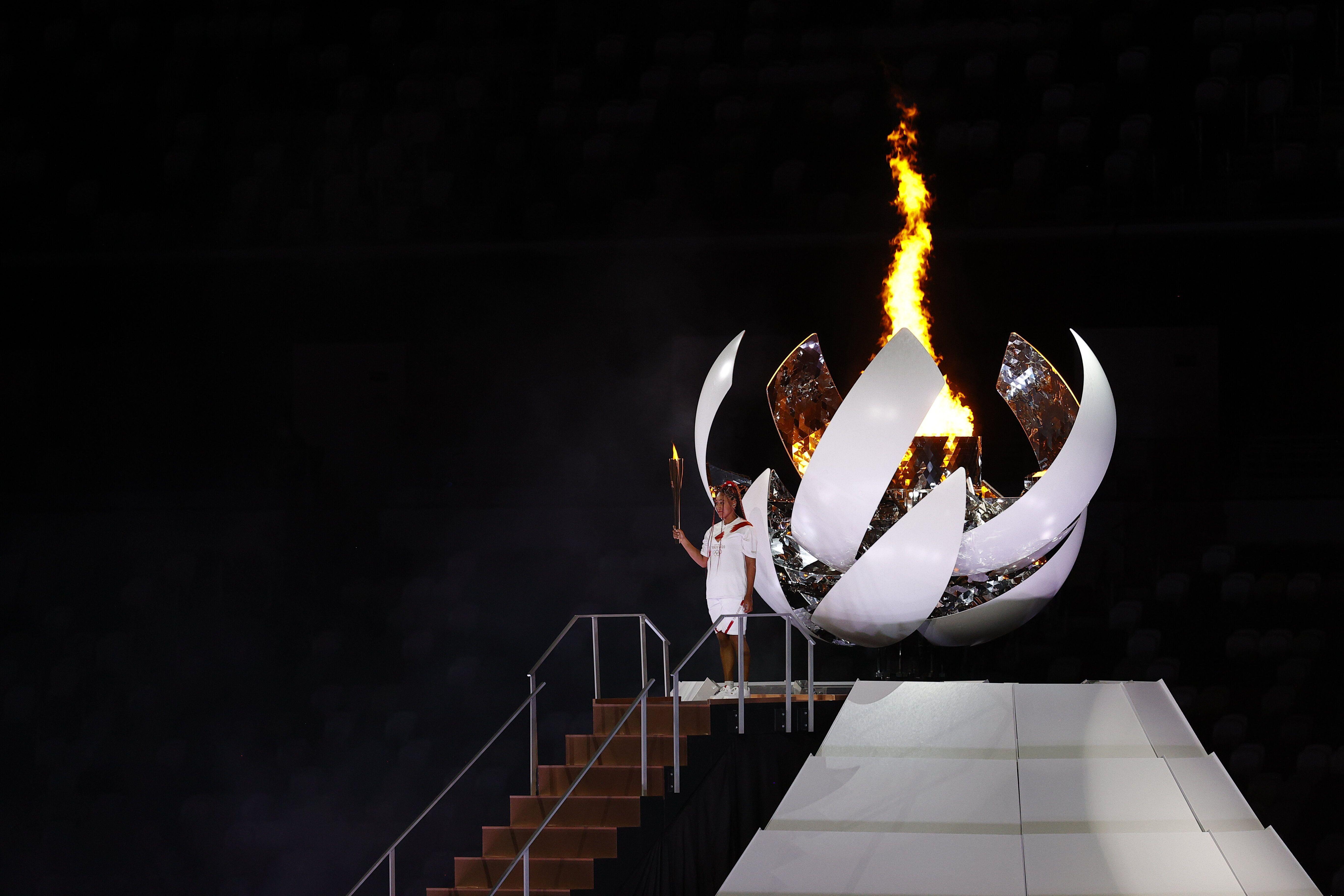 The Olympic Cauldron is lit.