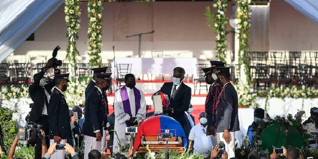 The funeral is held for slain Haitian President Jovenel Moise at his family home in Cap-Haitien, Haiti, on Friday, July 23. Moise was assassinated at his home in Port-au-Prince on July 7.