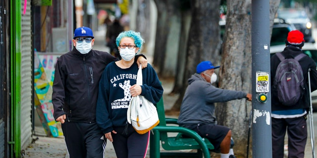 Los Angeles County reinstated a mask mandate last week amid surging COVID-19 cases. (Irfan Khan / Los Angeles Times via Getty Images)