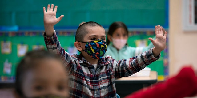 Kindergarten students participate in a classroom activity on the first day of in-person learning at Maurice Sendak Elementary School in Los Angeles, April 13, 2021. (Associated Press)
