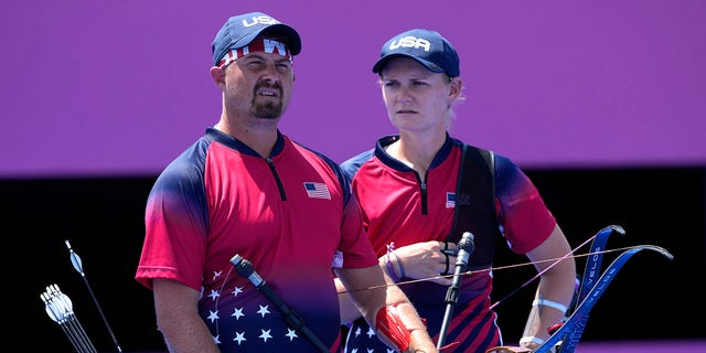United States' Brady Ellison, left, and his teammate Mackenzie Brown react during the mixed team competition against Indonesia at the 2020 Summer Olympics, Saturday, July 24, 2021, in Tokyo, Japan. (AP Photo/Alessandra Tarantino)