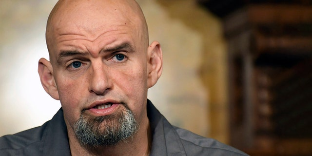 FILE - In this Jan. 24, 2019, file photo, Pennsylvania Lt. Gov. John Fetterman speaks at a news conference in the governor's Capitol reception room in Harrisburg, Pa. Fetterman running for the state's open U.S. Senate seat in 2022. (AP Photo/Marc Levy, File)