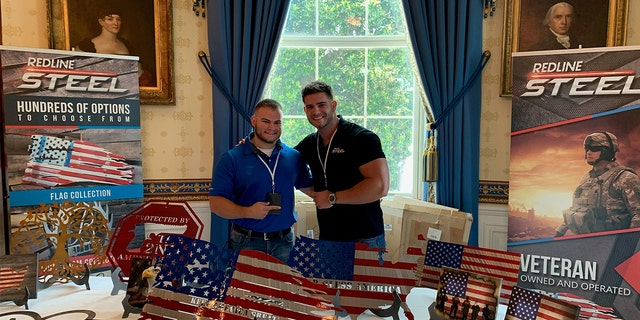 """Colin Wayne, an Army combat veteran and CEO of Redline Steel in Alabama, on the right, with his brother, Coleman Erwin (L), an Army veteran. The picture was taken on July 15, 2019, at the White House when Redline Steel was invited to be part of the """"Made in America"""" business showcase."""