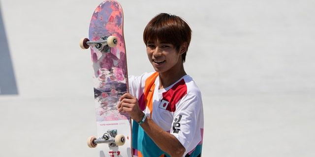 Yuto Horigome of Japan reacts after skating during the men's street skateboarding finals at the 2020 Summer Olympics, Sunday, July 25, 2021, in Tokyo, Japan. (AP Photo/Jae C. Hong)