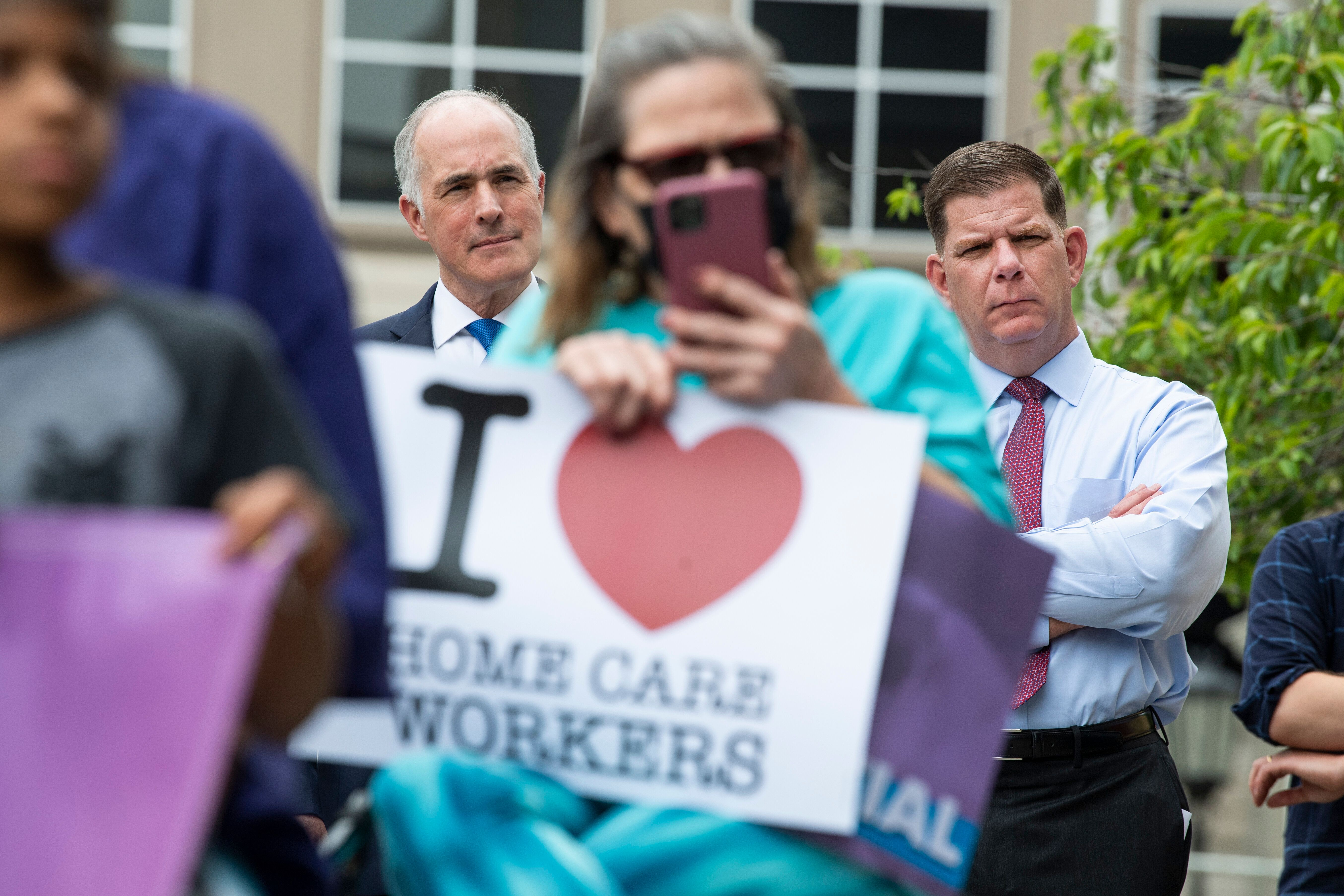 Secretary of Labor Marty Walsh, right, and Sen. Bob Casey (D-Pa.) attend the Care Can't Wait rally with the Service Employees