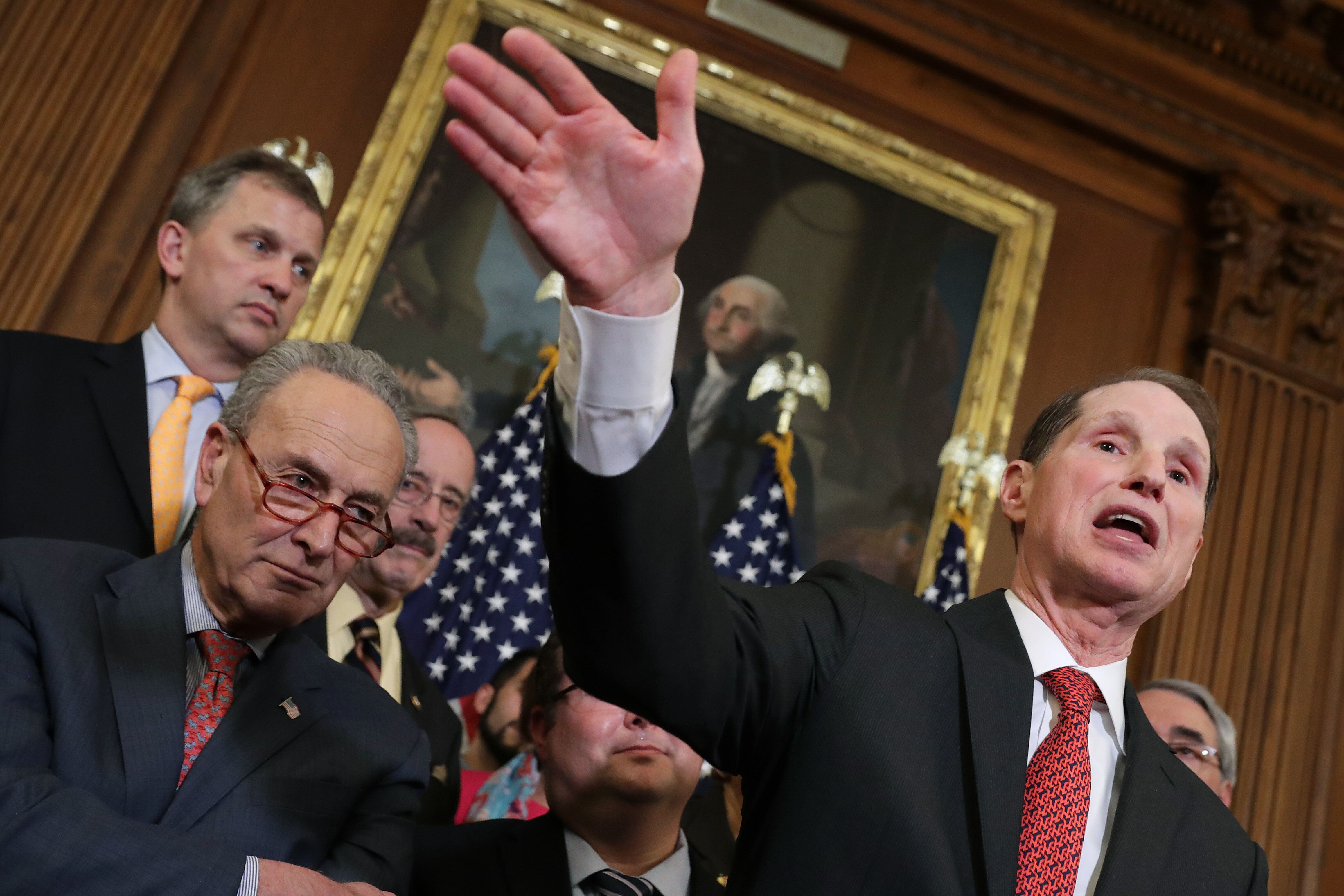 Sens. Ron Wyden (D-Ore.) and Chuck Schumer (D-N.Y.) lead a rally ahead of a House vote on health care and prescription drug l
