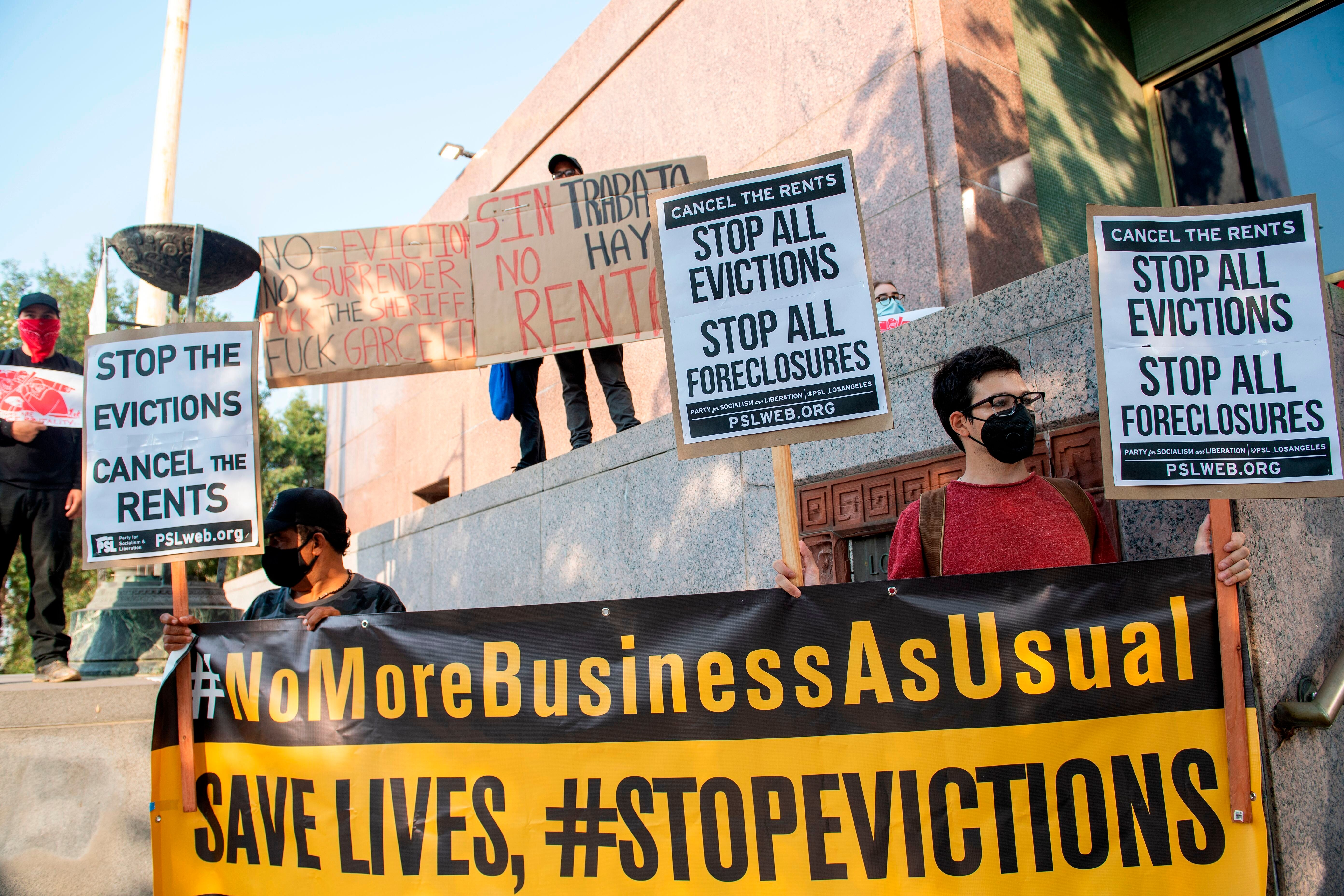 Renters and housing advocates protest to cancel rent and stop evictions amid the coronavirus pandemic on Aug. 21, 2020, in Lo