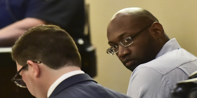 Murder defendant Otis McKane looks around the 379th District Court in San Antonio during his capital murder trial in the shooting death of San Antonio Police Dept. officer Benjamin Marconi on Monday. (AP/The San Antonio Express-News)