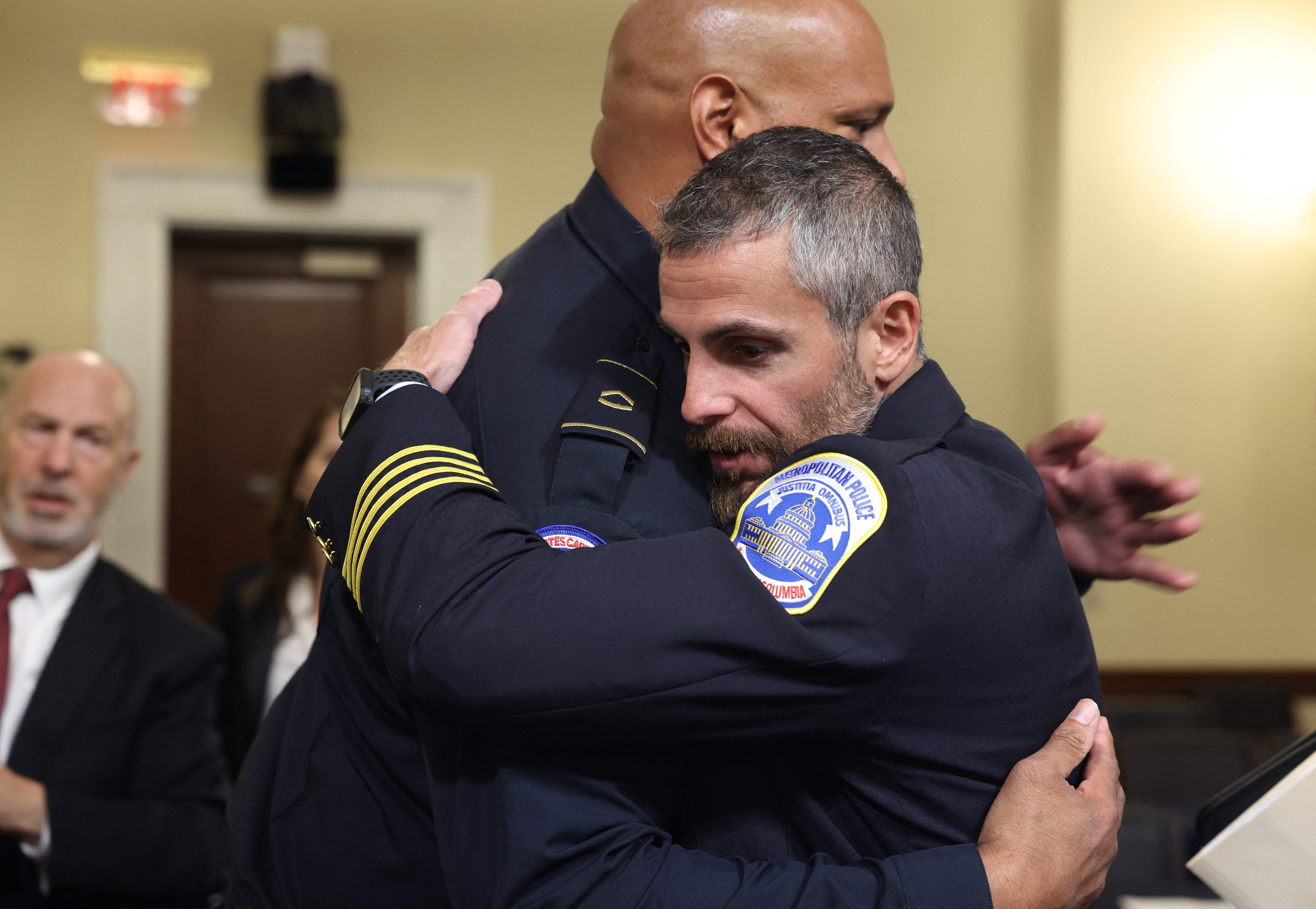 Officer Harry Dunn and Officer Michael Fanone embrace.