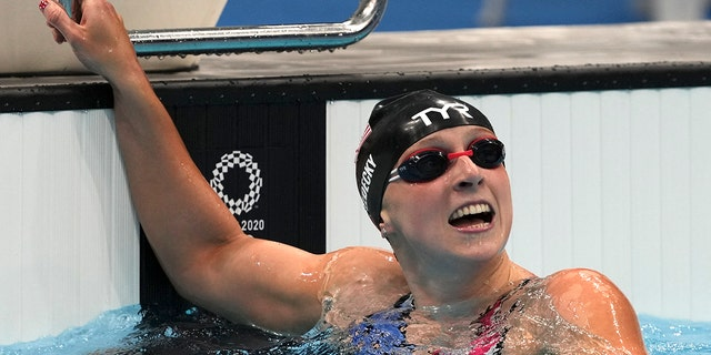 Katie Ledecky of the United States celebrates winning the women's 1500-meters freestyle final at the 2020 Summer Olympics, Wednesday, July 28, 2021, in Tokyo, Japan. (AP Photo/Matthias Schrader)