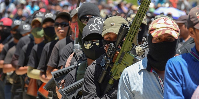 """Vigilantes of """"El Machete"""" as they call themselves, an armed group made up mostly of indigenous people to defend themselves against drug cartels, are seen during an assembly with indigenous communities, in Pantelho, Mexico on July 18."""