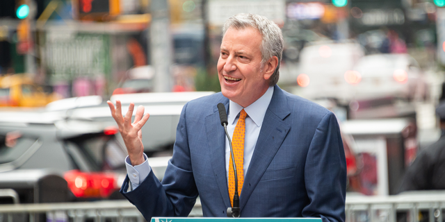 Mayor of New York City Bill de Blasio attends the opening of a vaccination center for Broadway workers in Times Square on April 12, 2021 in New York City. De Blasio and his top health officials Wednesday were reluctant to re-implement a mask mandate without data from the CDC to support its new guidelines.