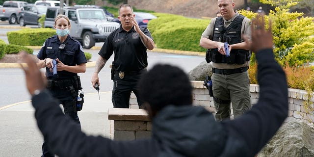 Ken Westphal, center, an officer with the Lacey Police Department and an instructor at the Washington state Criminal Justice Training Commission, works with cadets LeAnne Cone, of the Vancouver Police Department, and Kevin Burton-Crow, right, of the Thurston County Sheriff's Department, during a training exercise Wednesday, July 14, 2021.