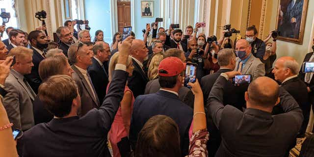Republican congressmen and staffers protest the new mask mandate in the House chamber, July 29, 2021.