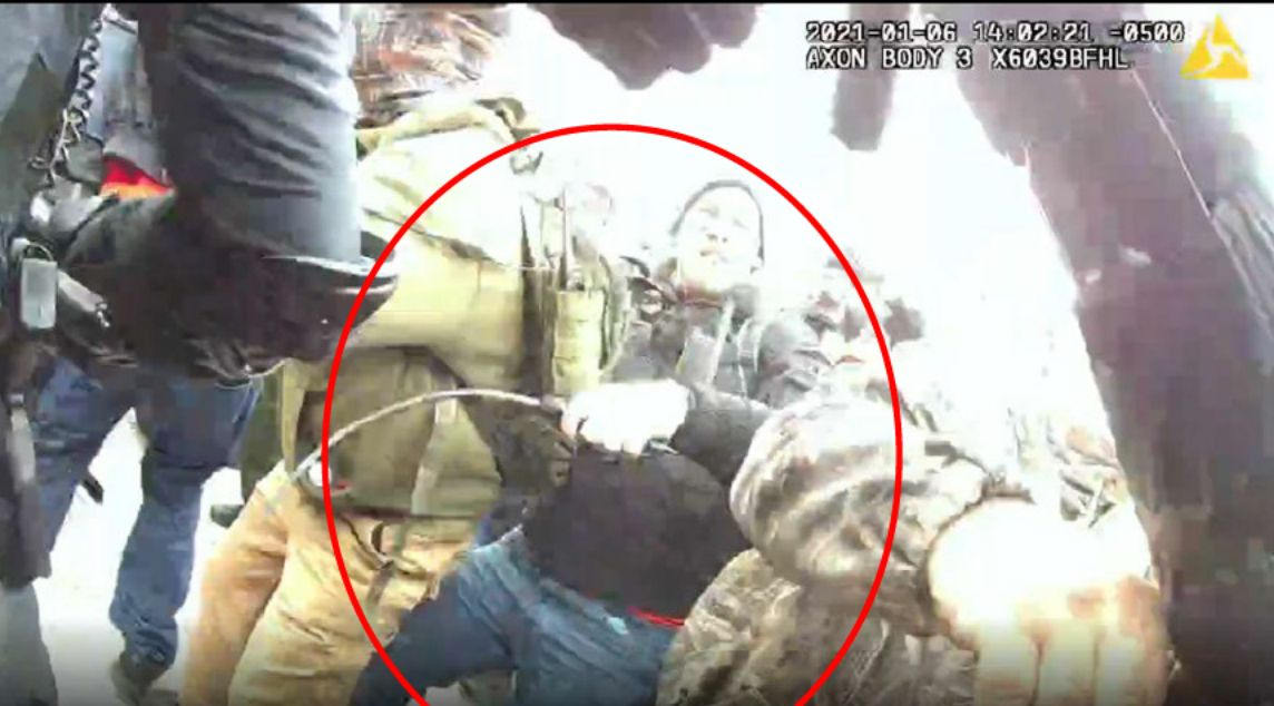 The FBI says this image shows Taake holding a metal whip as he battled officers at the Capitol on Jan. 6.